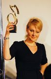 Renata Litvonova holding Kommersant Weekend prize Royalty Free Stock Photography