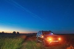 Renault Duster under the sky on which a rare celestial phenomeno royalty free stock image