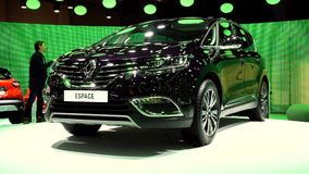 Renault Espace V MPV. Purple Renault Espace V MPV moving on a rotating platform on display at the 2015 Brussels Motor Show