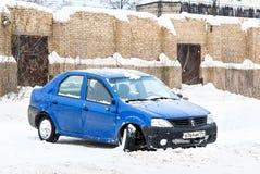 Renault Logan. ASHA, RUSSIA - NOVEMBER 19, 2011: Crashed motor car Renault Logan in the city street stock photography