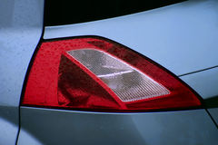 Renault Megane II rear lamp. Rear light of Renault Megane II with rain drops Stock Photography