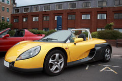 Renault soft-top convertible roadster sportscar. A lovely example of a Renault 2 seater convertible sports coupe in stunning yellow and grey colours Stock Photography