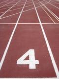 Renbaan 4 van de atletiek Stock Foto's