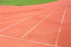 Renbaan voor de atletenachtergrond Stock Afbeelding