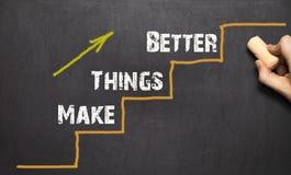Renda le cose migliori - concetto di miglioramento immagine stock
