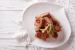 Rendang beef with spices close-up on a plate. Horizontal top vie Stock Photo