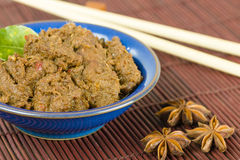 Rendang Daging. Dried beef curry with coconut milk and spices. Traditional Indonesia, Malaysian and Singaporean dish Royalty Free Stock Photos
