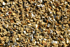 Render. Close up abstract photo of pebbledash render on a house wall royalty free stock images