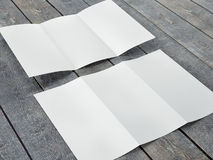 Render of Blank Template of Trifold Leaflet A4 Size. On a wood background Royalty Free Stock Images