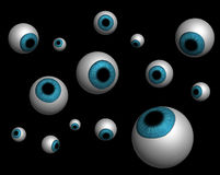 Rendered eyeballs on black Stock Images