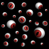 Rendered eyeballs on black. Rendered 3D red demonic eyeballs on black background Royalty Free Stock Photos