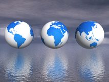 Rendered image of three globes above the water Stock Photos