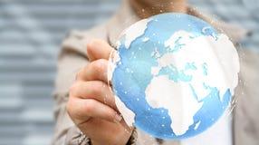 Rendering' tactile numérique émouvant du monde '3D d'homme d'affaires Image libre de droits