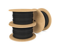 Rendering of black industrial underground cable on large wooden reel. 3d rendering of roll of black industrial underground cable on large wooden reel isolated on Royalty Free Stock Images