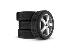 Rendering black wheels with one in profile isolated on white background. 3d rendering black wheels with one in profile isolated on white background. Rubber and Stock Photos