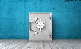 Rendering closed safe box on background of blue wall and grey wood floor. 3d rendering of a closed safe box on a background of a blue wall and a grey wood floor Royalty Free Stock Photo