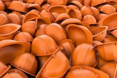 Rendering endless pile of orange plastic work helmet`s. Royalty Free Stock Photos