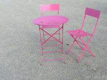 Rendezvous with bistro chairs. Rendezvous with two bistro chairs around a table Stock Photography