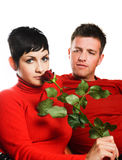 Rendezvous in red. Young couple is having a date. The woman got a red rose Royalty Free Stock Image