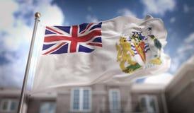 Rendição antártica britânica da bandeira 3D do território no céu azul Buildi Imagens de Stock Royalty Free