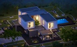 rendição 3d da casa moderna no jardim na noite Imagem de Stock