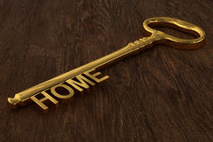 rendição 3D de uma chave da casa do vintage em de madeira fotos de stock royalty free