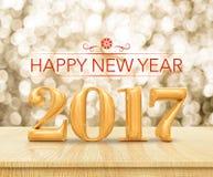 Rendição 3d do ano novo feliz 2017 de cor vermelha no tampo da mesa de madeira w Imagens de Stock