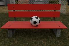 rendição 3d do banco de parque vermelho com a bola nela Fotos de Stock Royalty Free