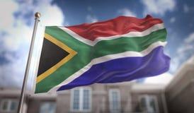Rendição da bandeira 3D de África do Sul no fundo da construção do céu azul Imagens de Stock Royalty Free