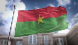 Rendição da bandeira 3D de Burkina Faso no fundo da construção do céu azul Imagens de Stock