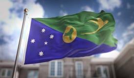 Rendição da bandeira 3D de Ilhas Christmas no céu azul que constrói Backgrou Fotografia de Stock Royalty Free