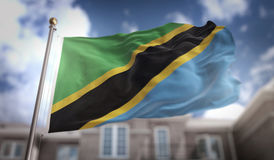 Rendição da bandeira 3D de Tanzânia no fundo da construção do céu azul Foto de Stock