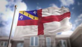 Rendição da bandeira 3D do Herm no fundo da construção do céu azul Imagens de Stock Royalty Free