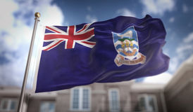 Rendição de Falkland Islands Flag 3D no céu azul que constrói Backgrou Foto de Stock