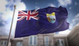 Rendição de Helena Flag 3D de Saint no fundo da construção do céu azul Fotos de Stock
