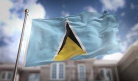 Rendição de Lucia Flag 3D de Saint no fundo da construção do céu azul Imagem de Stock Royalty Free