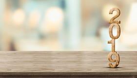 Rendição de madeira do número 3d do ano novo 2019 na tabela de madeira no borrão imagens de stock royalty free