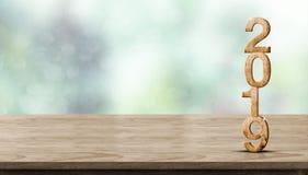 Rendição de madeira do número 3d do ano novo 2019 na tabela de madeira no borrão imagem de stock royalty free