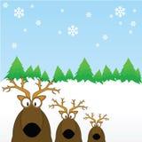 Rendieren uit in de sneeuw Stock Afbeeldingen