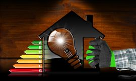 Rendimento energetico - House di modello e lampadina Immagine Stock Libera da Diritti
