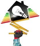 Rendimento energetico - House di modello e lampadina Fotografie Stock