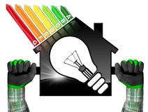 Rendimiento energético - House modelo y bombilla Imagen de archivo