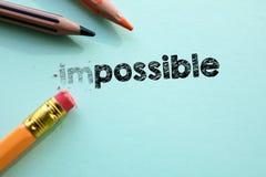 Rendre impossible dedans à possible par la gomme Photo stock