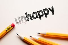 Rendre malheureux dedans à heureux par la gomme Photographie stock