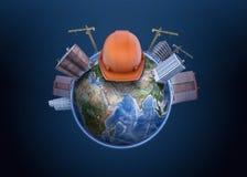 rendu 3d de globe de la terre avec de hauts immeubles construits là-dessus avec des grues, et un casque antichoc au milieu illustration stock