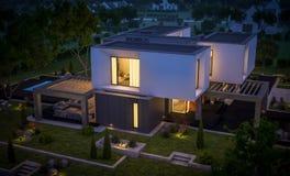 rendu 3d de maison moderne dans le jardin la nuit Photographie stock libre de droits