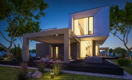 rendu 3d de maison moderne dans le jardin la nuit Image libre de droits