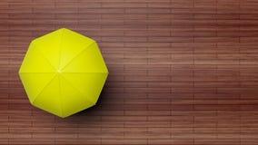 rendu 3D de parapluie jaune sur la surface en bois Image stock