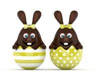 rendu 3d des lapins de chocolat de Pâques dans des coquilles d'oeufs Photographie stock