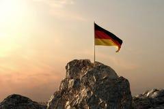 rendu 3d d'onduler le drapeau allemand sur le paysage rocheux illustration stock
